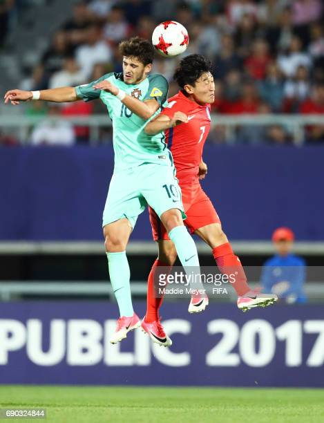 Xadas of Portugal wins a ball out of the air over Lee Jinhyun of Korea Republic during the FIFA U20 World Cup Korea Republic 2017 Round of 16 match...