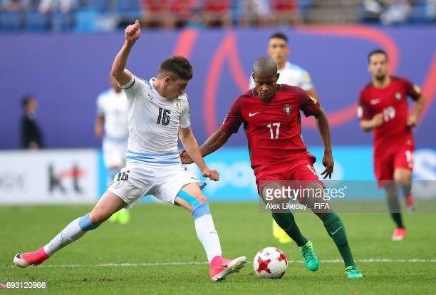 Xande Silva of Portugal is tackled by Federico Valverde of Uruguay during the FIFA U20 World Cup Korea Republic 2017 Quarter Final match between...