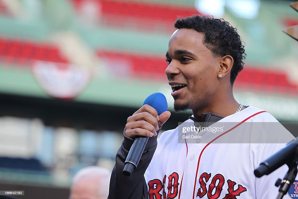 Xander Bogaerts addresses the crowd on stage at Fenway Park before the Red Sox players board the duck boats for the World Series victory parade for the Boston Red Sox on November 2, 2013 in Boston, Massachusetts.