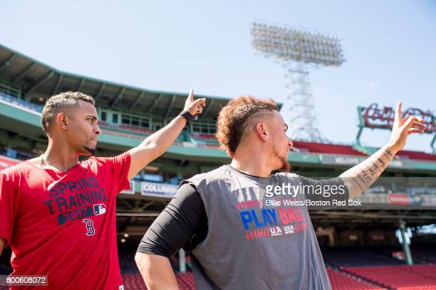 Xander Bogaerts and Christian Vazquez of the Boston Red Sox react before a game against the Los Angeles Angels of Anaheim on June 24 2017 at Fenway...
