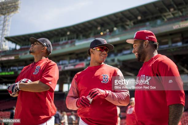 Xander Bogaerts Marco Hernandez and Pablo Sandoval of the Boston Red Sox react during batting practice before a game against the Tampa Bay Rays on...