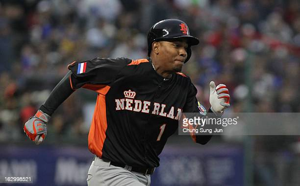 Xander Bogaerts of Netherlands run into first base in the eighth inning during the World Baseball Classic First Round Group B match between the...