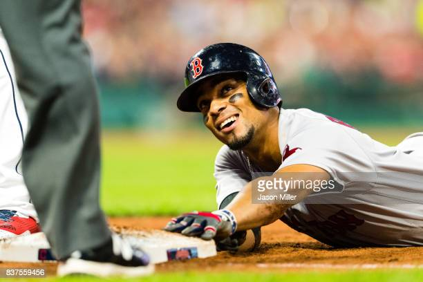 Xander Bogaerts of the Boston Red Sox asks for time out from the first base umpire after diving back to first during the fourth inning against the...