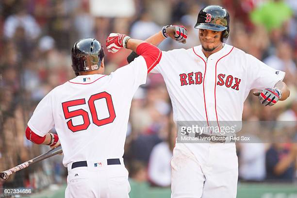 Xander Bogaerts of the Boston Red Sox celebrates a tworun home run against the New York Yankees with Mookie Betts in the fifth inning on September 17...