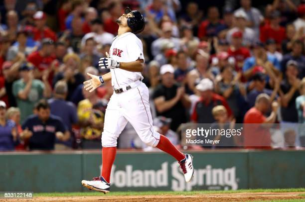 Xander Bogaerts of the Boston Red Sox celebrates after hitting a home run against the St Louis Cardinals during the ninth inning at Fenway Park on...