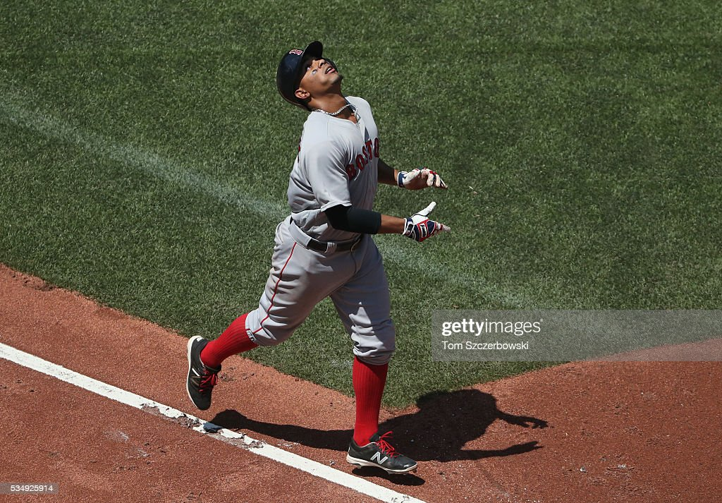 <a gi-track='captionPersonalityLinkClicked' href=/galleries/search?phrase=Xander+Bogaerts&family=editorial&specificpeople=9461957 ng-click='$event.stopPropagation()'>Xander Bogaerts</a> #2 of the Boston Red Sox celebrates after hitting a solo home run in the fourth inning during MLB game action against the Toronto Blue Jays on May 28, 2016 at Rogers Centre in Toronto, Ontario, Canada.