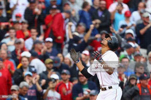 Xander Bogaerts of the Boston Red Sox celebrates after hitting a solo home run in the first inning against the Houston Astros during game four of the...