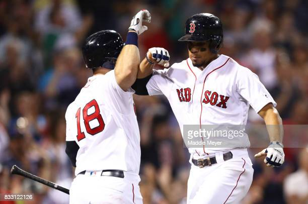 Xander Bogaerts of the Boston Red Sox celebrates with Mitch Moreland after hitting a home run against the St Louis Cardinals during the ninth inning...