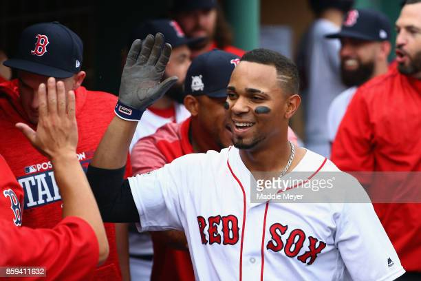 Xander Bogaerts of the Boston Red Sox celebrates with teammates in the dugout after hitting a solo home run in the first inning against the Houston...