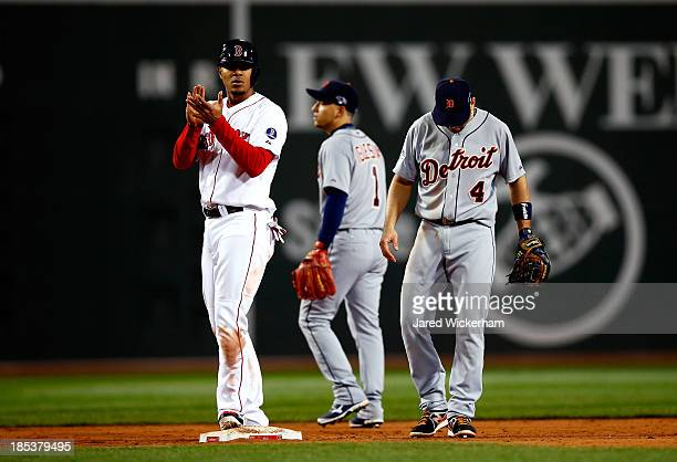 Xander Bogaerts of the Boston Red Sox claps on second base after being called safe in the seventh inning against the Detroit Tigers during Game Six...