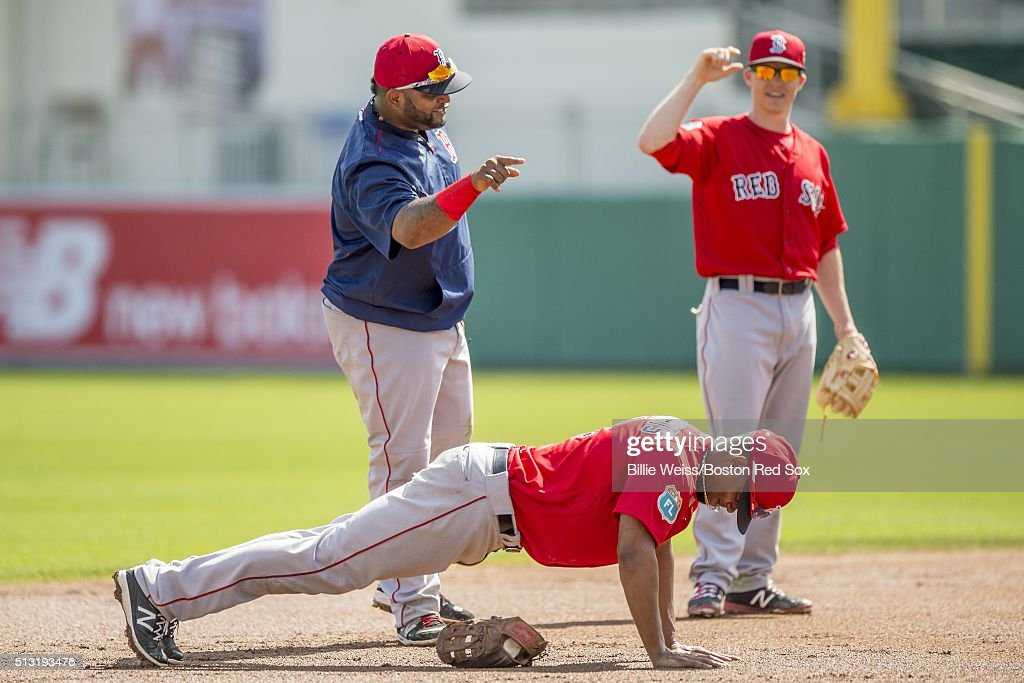 Xander Bogaerts #2 of the Boston Red Sox does pushups as Pablo Sandoval #48 and Brock Holt #12 look on during a team workout on March 1, 2016 at Fenway South in Fort Myers, Florida .