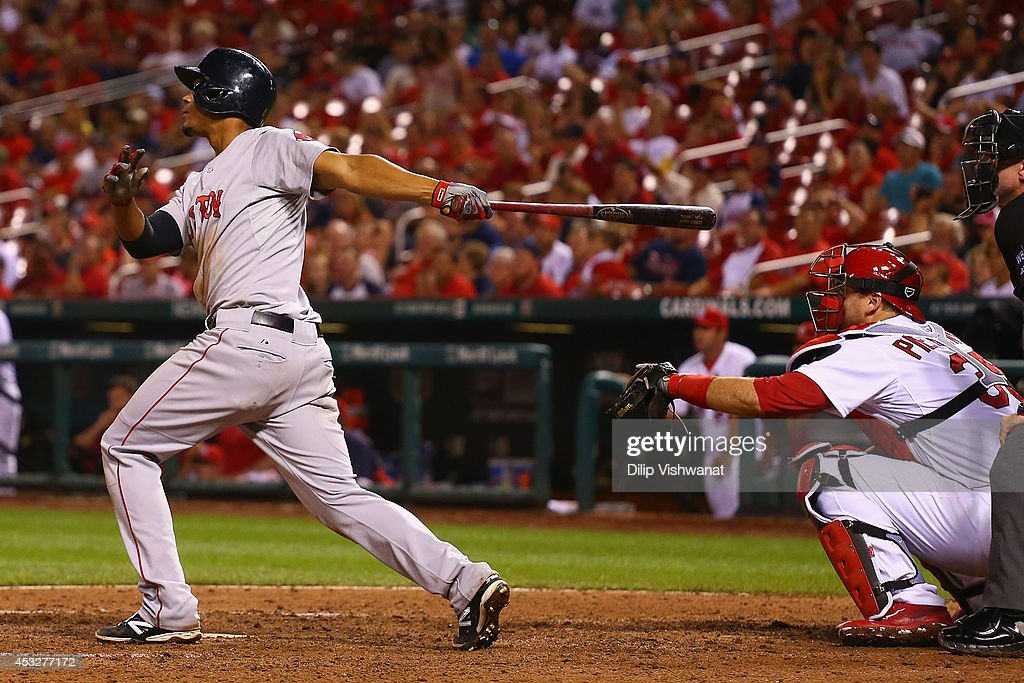 <a gi-track='captionPersonalityLinkClicked' href=/galleries/search?phrase=Xander+Bogaerts&family=editorial&specificpeople=9461957 ng-click='$event.stopPropagation()'>Xander Bogaerts</a> #2 of the Boston Red Sox drives in the game-winning run with a sacrifice fly against the St. Louis Cardinals in the ninth inning at Busch Stadium on August 6, 2014 in St. Louis, Missouri. The Red Sox beat the Cardinals 2-1.