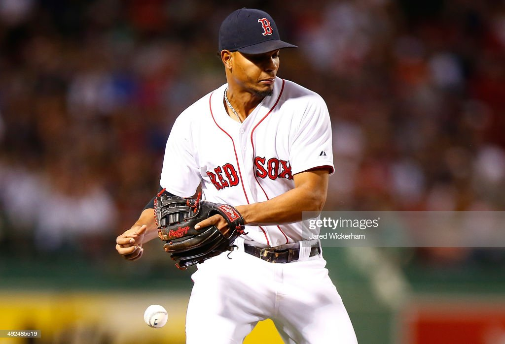 Xander Bogaerts #2 of the Boston Red Sox drops a ground ball in the fifth inning against the Toronto Blue Jays during the game at Fenway Park on May 20, 2014 in Boston, Massachusetts.