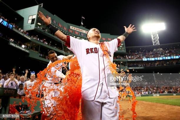 Xander Bogaerts of the Boston Red Sox dunks Christian Vazquez with Powerade after Vazquez hit a three run homer to defeat the Cleveland Indians 1210...