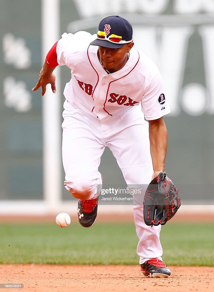 <a gi-track='captionPersonalityLinkClicked' href=/galleries/search?phrase=Xander+Bogaerts&family=editorial&specificpeople=9461957 ng-click='$event.stopPropagation()'>Xander Bogaerts</a> #72 of the Boston Red Sox fields a ground ball against the New York Yankees during the game on September 14, 2013 at Fenway Park in Boston, Massachusetts.