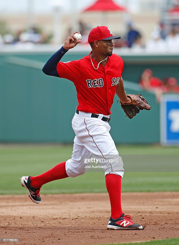 Xander Bogaerts of the Boston Red Sox fields the ball hit by Carlos Ruiz #51 (not pictured) of the Philadelphia Phillies and throws him out at first base during the second inning of a spring training game at JetBlue Park on March 27, 2016 in Fort Myers, Florida. The Red Sox defeated the Phillies 5-1.
