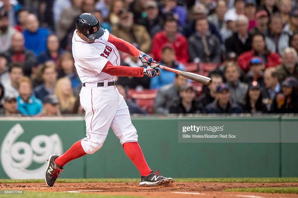 Xander Bogaerts #2 of the Boston Red Sox hits a double during the first inning of a game against the Colorado Rockies on May 24, 2016 at Fenway Park in Boston, Massachusetts.