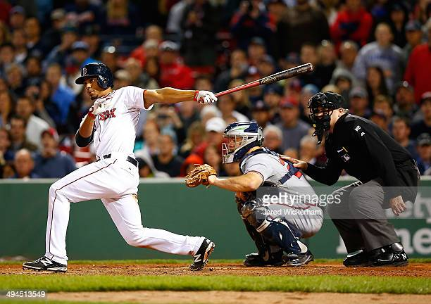 Xander Bogaerts of the Boston Red Sox hits the walkoff gamewinning RBI single in the 9th inning against the Atlanta Braves during the game at Fenway...