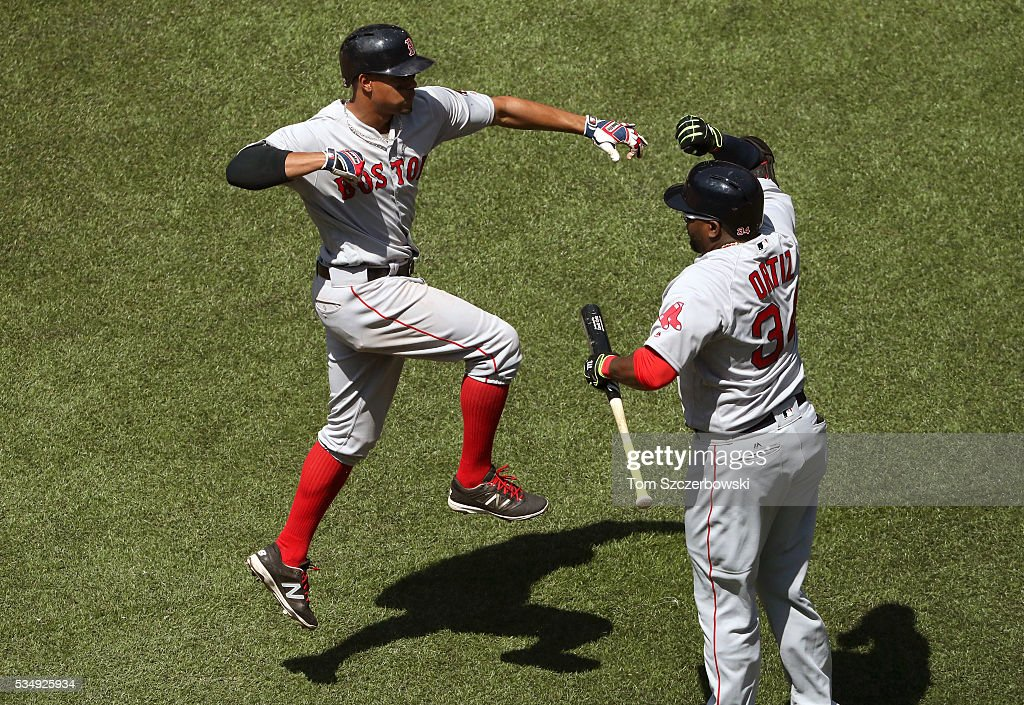 <a gi-track='captionPersonalityLinkClicked' href=/galleries/search?phrase=Xander+Bogaerts&family=editorial&specificpeople=9461957 ng-click='$event.stopPropagation()'>Xander Bogaerts</a> #2 of the Boston Red Sox is congratulated by <a gi-track='captionPersonalityLinkClicked' href=/galleries/search?phrase=David+Ortiz&family=editorial&specificpeople=175825 ng-click='$event.stopPropagation()'>David Ortiz</a> #34 after hitting a solo home run in the fourth inning during MLB game action against the Toronto Blue Jays on May 28, 2016 at Rogers Centre in Toronto, Ontario, Canada.