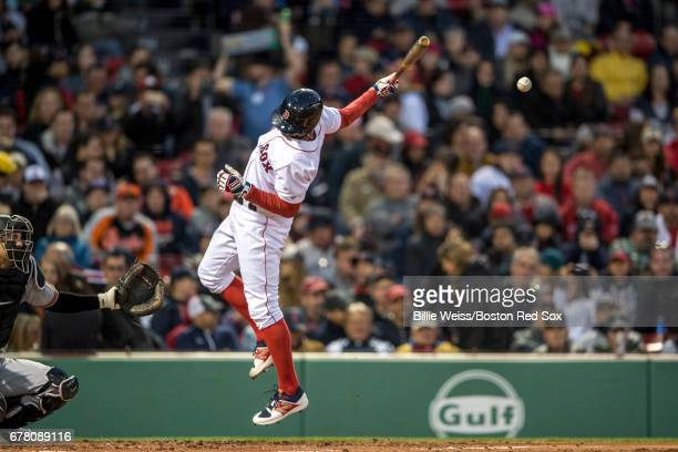 Xander Bogaerts of the Boston Red Sox is hit by Kevin Gausman of the Baltimore Orioles during the second inning of a game on May 3 2017 at Fenway...