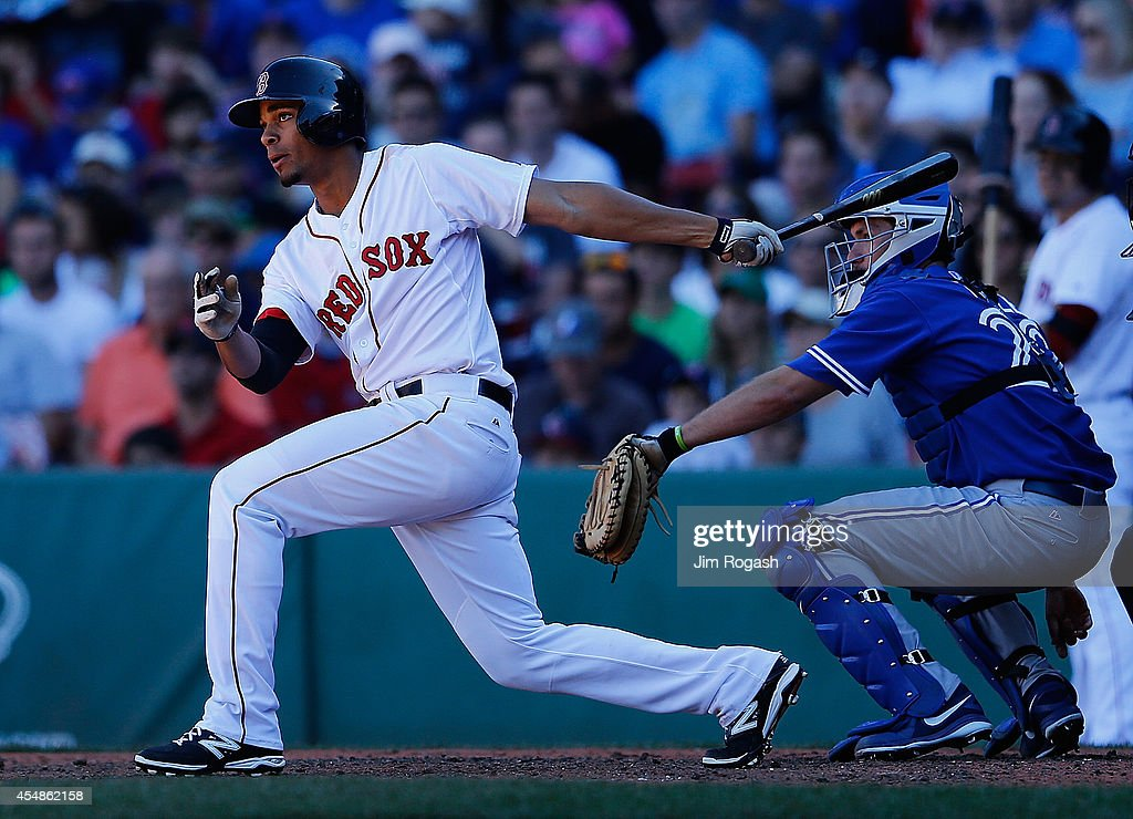Xander Bogaerts #2 of the Boston Red Sox knocks in a run against the Toronto Blue Jays in the sixth inning at Fenway Park on September 7, 2014 in Boston, Massachusetts.