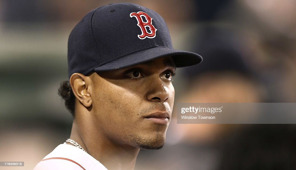 Xander Bogaerts #72 of the Boston Red Sox looks on from the dugout during the eighth inning of the game against the Baltimore Orioles at Fenway Park on August 29, 2013 in Boston, Massachusetts.