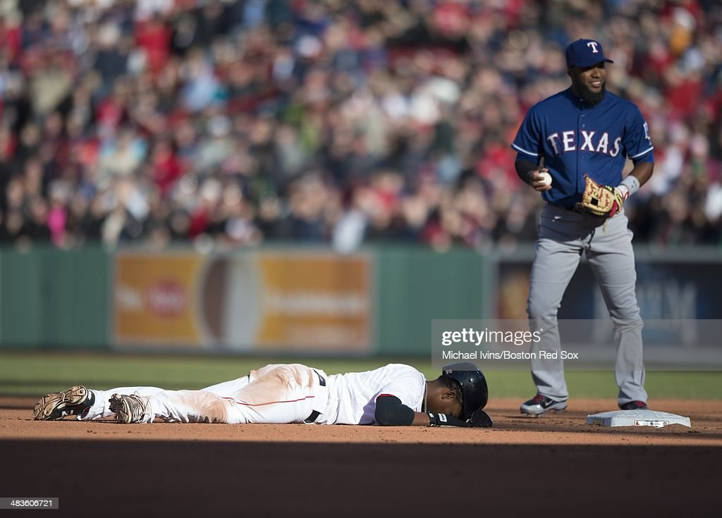 Xander Bogaerts #2 of the Boston Red Sox reacts after being tagged out by Elvis Andrus #1 of theTexas Rangers after over sliding second base on a steal attempt in the fourth inning at Fenway Park on April 9, 2014 in Boston, Massachusetts.