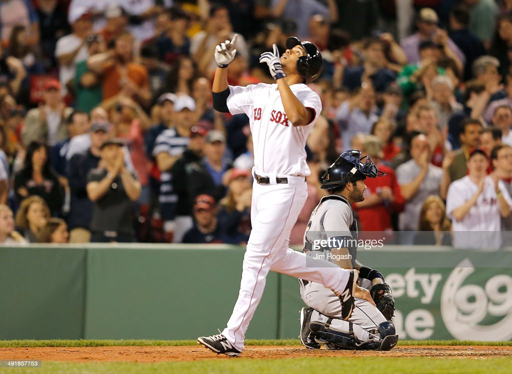 Xander Bogaerts of the Boston Red Sox reacts after he hit a home run as Alex Avila of the Detroit Tigers looks away in the fifth inning at Fenway...