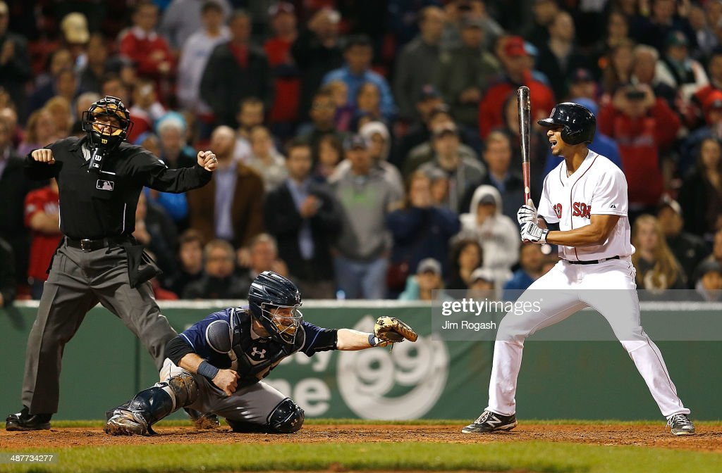 Xander Bogaerts #2 of the Boston Red Sox reacts after striking out in the ninth with men on base as Ryan Hanigan #24 of the Tampa Bay Rays catches the ball in game two of a doubleheader at Fenway Park May 1, 2014 in Boston, Massachusetts.