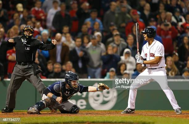 Xander Bogaerts of the Boston Red Sox reacts after striking out in the ninth with men on base as Ryan Hanigan of the Tampa Bay Rays catches the ball...