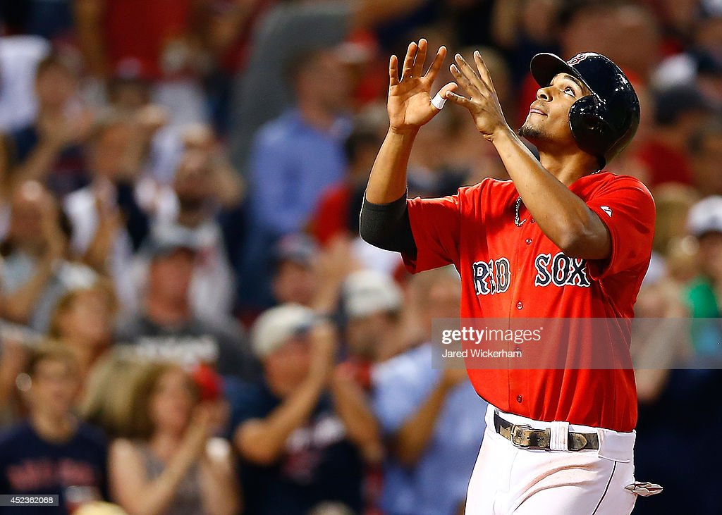 Xander Bogaerts #2 of the Boston Red Sox reacts at home plate after hitting a two-run home run in the sixth inning against the Kansas City Royals during the game at Fenway Park on July 18, 2014 in Boston, Massachusetts.