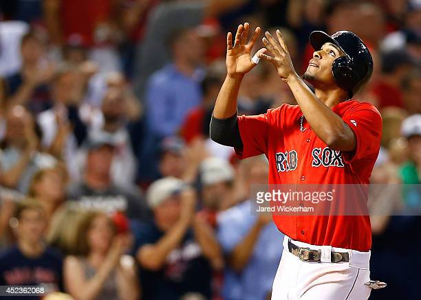 Xander Bogaerts of the Boston Red Sox reacts at home plate after hitting a tworun home run in the sixth inning against the Kansas City Royals during...