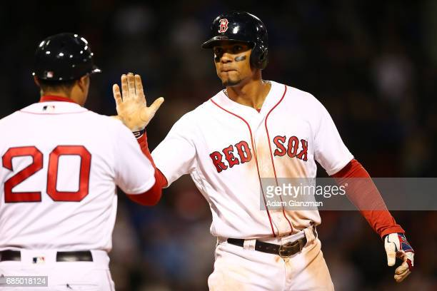 Xander Bogaerts of the Boston Red Sox reacts during a game against the Chicago Cubs at Fenway Park on April 30 2017 in Boston Massachusetts