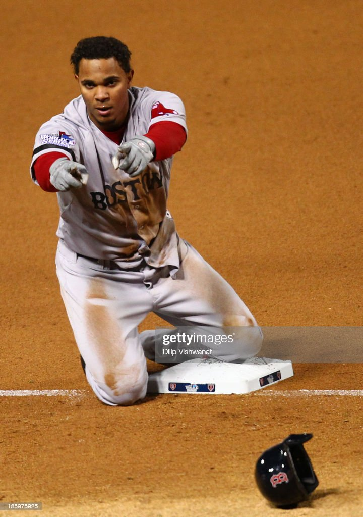 Xander Bogaerts #72 of the Boston Red Sox reacts on third after hitting a tripple in the fifth inning against the St. Louis Cardinals during Game Three of the 2013 World Series at Busch Stadium on October 26, 2013 in St Louis, Missouri.