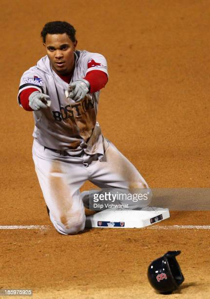 Xander Bogaerts of the Boston Red Sox reacts on third after hitting a tripple in the fifth inning against the St Louis Cardinals during Game Three of...
