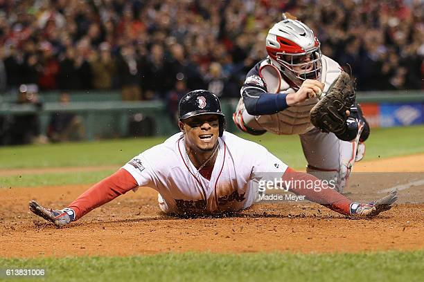 Xander Bogaerts of the Boston Red Sox scores a run in the fifth inning against the Cleveland Indians during game three of the American League Divison...