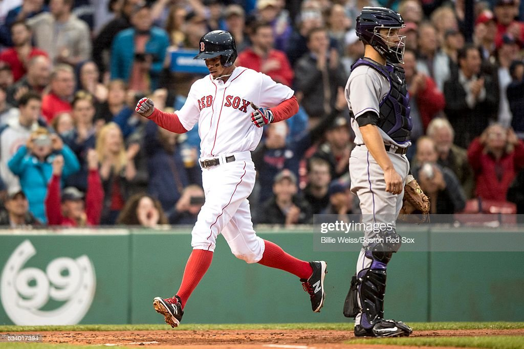 Xander Bogaerts #2 of the Boston Red Sox scores during the first inning of a game against the Colorado Rockies on May 24, 2016 at Fenway Park in Boston, Massachusetts.