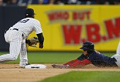 Xander Bogaerts of the Boston Red Sox slides into second base with a double before shortstop Didi Gregorius of the New York Yankees can make the tag...