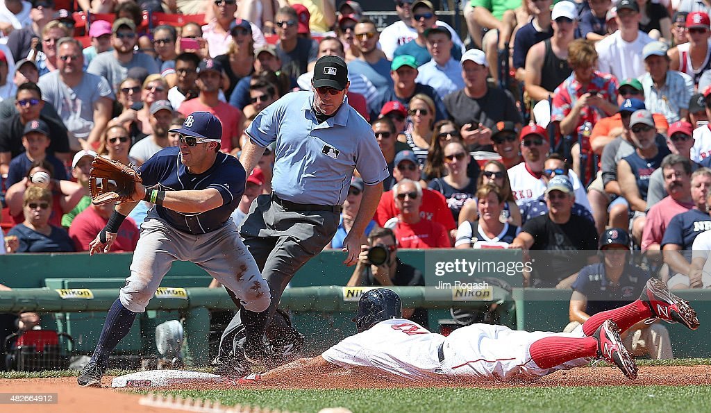 Xander Bogaerts #2 of the Boston Red Sox steals third as Evan Longoria #3 of the Tampa Bay Rays takes the throw in the second inning at Fenway Park on August 1, 2015 in Boston, Massachusetts.