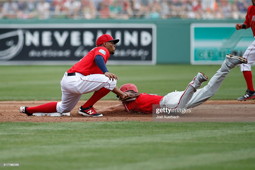 Xander Bogaerts of the Boston Red Sox tags out David Lough #3 of the Philadelphia Phillies attempting to steal during th second inning of a spring training game at JetBlue Park on March 27, 2016 in Fort Myers, Florida. The Red Sox defeated the Phillies 5-1.