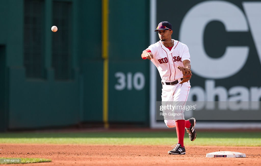Xander Bogaerts #2 of the Boston Red Sox throws to first base for an out against the Oakland Athletics at Fenway Park during the fifth inning on June 6, 2015 in Boston, Massachusetts. The Red Sox won 4-2.