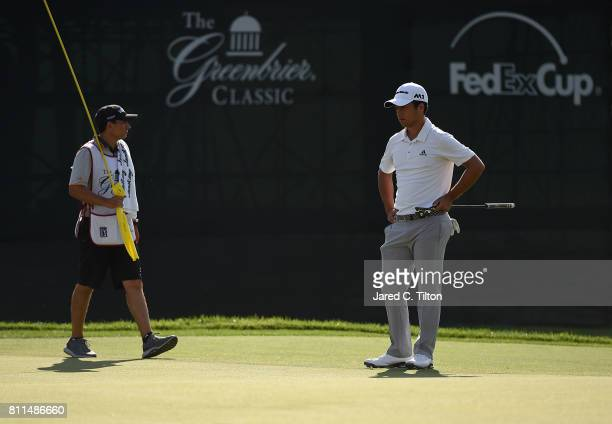 Xander Schauffele and his caddie wait on the 18th green during the final round of The Greenbrier Classic held at the Old White TPC on July 9 2017 in...