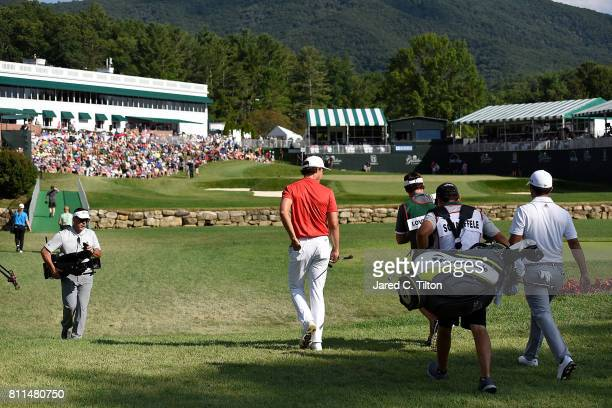 Xander Schauffele and Jamie Lovemark walk the 18th hole during the final round of The Greenbrier Classic held at the Old White TPC on July 9 2017 in...