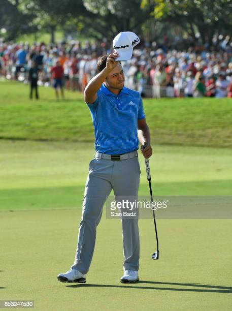 Xander Schauffele celebrates his one stroke victory on the 18th hole green during the final round of the TOUR Championship the final event of the...