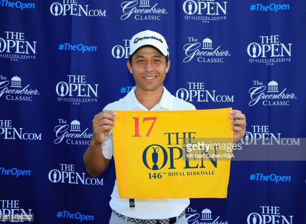 Xander Schauffele holds a hole flag after qualifying for the Open Championship during the fourth and final round of The Greenbrier Classic held at...