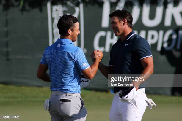 Xander Schauffele is greeted by Brooks Koepka after the final round of the PGA Tour Championship on September 24 2017 at East Lake Golf Club in...
