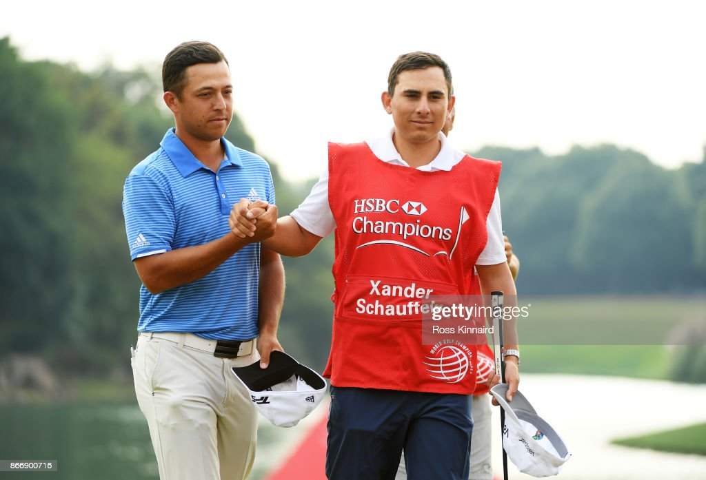 Xander Schauffele of the United States and his caddie Austin Kaiser react on the 18th green during the second round of the WGC - HSBC Champions at Sheshan International Golf Club on October 27, 2017 in Shanghai, China.