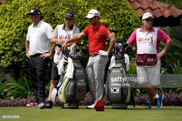 Xander Schauffele of the United States and his compatriot Pat Perez waits on the 5th hole during the final round of the 2017 CIMB Classic at TPC...