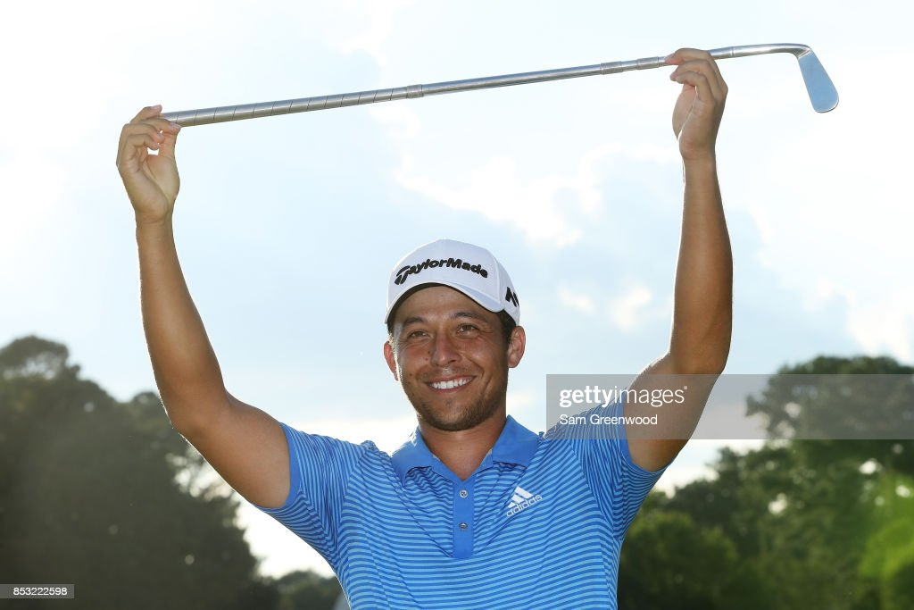 Xander Schauffele of the United States celebrates with the Calamity Jane trophy on the 18th green after winning during the final round of the TOUR Championship at East Lake Golf Club on September 24, 2017 in Atlanta, Georgia.