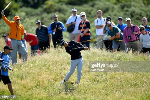 Xander Schauffele of the United States hits his second shot on the 2nd hole during a practice round prior to the 146th Open Championship at Royal...